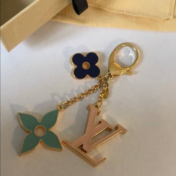 72bb0a09354b Louis Vuitton Accessories - LV Fleur de Monogram Bag Charm  Key Chain